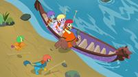 Yona climbing into the canoe S8E9