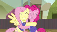 Fluttershy and Pinkie Pie hugging with joy S6E18