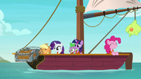 Applejack fishes a treasure chest out of the sea S6E22