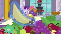 Banana levitating away from breakfast table S7E10