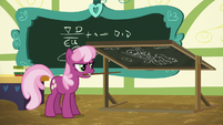 Cheerilee angrily turns the chalkboard around S6E15