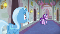 Starlight winks at Trixie from down the hall S9E20