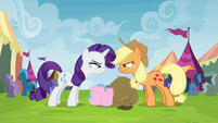 Applejack and Rarity glaring at each other S4E22