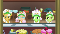 Gold Horseshoe Gals with empty lunch trays S8E5