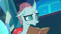 Ocellus reading a reference book S8E26