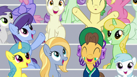 Spectators cheer for the cheer squad S9E15