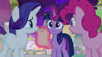 Twilight Sparkle takes out a scroll S9E17