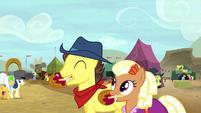 Appleloosa ponies enjoying caramel apples S5E6