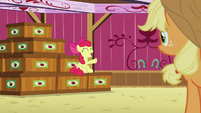 Apple Bloom sitting on stacked crates S6E23