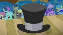 Ponies stare at the top hat S4E25