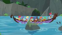 AJ, Rainbow, and students canoe downstream S8E9