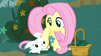 Angel giving a flower to Fluttershy S8E18