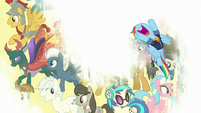 Rainbow Dash flying over a white screen S9E26