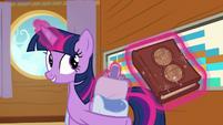 Twilight Sparkle takes out an almanac S7E22