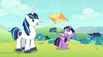 Young Twilight and Spike look up at kite S9E4