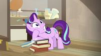 Starlight Glimmer slips on the stack of books S7E24