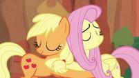 Applejack and Fluttershy hugging S8E23