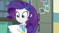 Rarity looking at the printed-out photo EGFF