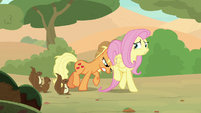 Applejack pushing Fluttershy along S8E23