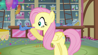 Fluttershy blowing a party horn S3E13