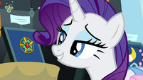 Rarity looking at vintage brooch S4E22