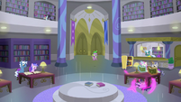 Twilight teleports under a library desk S9E5