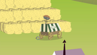 Pie cart in front of hay bales S4E17