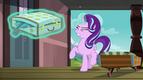 Starlight lifting Sunburst's heavy luggage S7E24