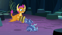 Smolder putting tree pieces in a pile S9E3