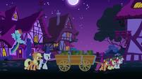 Crusaders hauling cart of boxes at nighttime S6E15