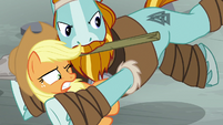 Rockhoof pushes Applejack out of the way S7E26