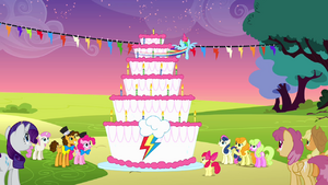 Rainbow spinning around the cake to blow all the candles S4E12.png