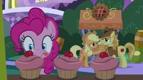 Pinkie Pie eyeing a pink cupcake S9E17