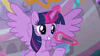 Twilight speaking into a microphone S9E7