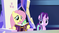 Fluttershy with a copy of the friendship journal S7E14