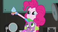 Pinkie Pie takes out a cupcake EGS2
