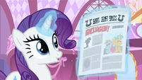 Rarity -ohhing- at newspaper S2E23