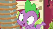 Spike holding a heavy stack of pies S6E10