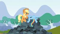 Rainbow Dash lying on top of rocks S3E09
