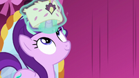 Starlight levitates a small hat over her horn S6E6