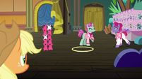 Trainer pony 2 trotting up to trainer pony 1 S6E20