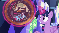 Twilight presenting an ancient shield S8E23