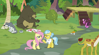 Angel and Dr. Fauna surrounded by chaos S9E18