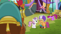 Sweetie Belle levitating helmet on Scootaloo's head S5E11
