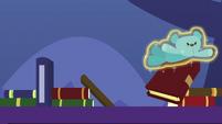 Blue teddy bear knocking over books S7E3