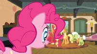 Pinkie Pie looking at the Apples arguing S4E09
