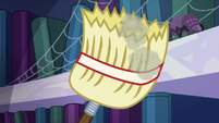 Spike swatting a spider with the broom S6E21