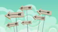 Cardboard arrows fly through the air S6E17