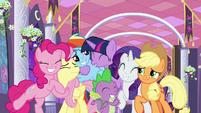 Twilight Sparkle hugging her friends S9E17