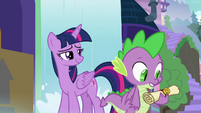 Spike holding a letter from Celestia S9E5